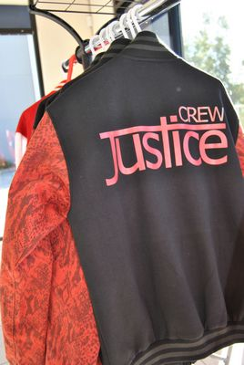 the justice crew baseball jackets hanging on rack